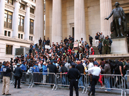 A crowd protests in public under the observation of police officers. © Daryl Lang/Shutterstock.com.