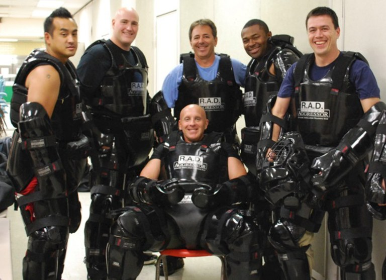 Photo provided by author of a group of male instructors who train and participate in the RAD class as aggressors.