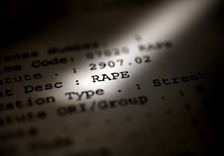 """An image highlighting the word """"Rape"""" in a police report. Photo provided by The Plain Dealer, Cleveland, Ohio."""