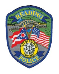 """The patch of the Reading, Ohio, Police Department shows a rainbow bridge, the first in Ohio and one of four remaining nationwide. Also depicted are the flags of the United States and Ohio. Below the flags is the city's seal, which contains the year the community was founded and the German words for """"We try our best."""""""