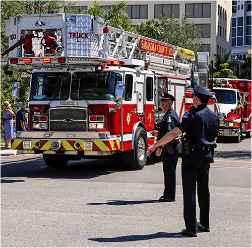 Police Officers and Fire and Emergency Vehicles at Scene