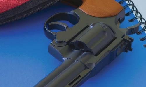 Revolver on Spiral Notebook