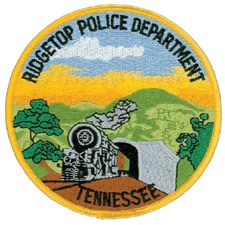 The patch of the Ridgetop, Tennessee, Police Department features a train emerging from a railroad tunnel, constructed in 1905 and one of the longest self-supporting tunnels in the world. When completed, it opened a direct line between Louisville, Kentucky, and Nashville and brought expansion, both in population and economy.