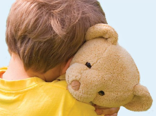 Depiction of a child gaining peace and security by embracing a stuffed animal.