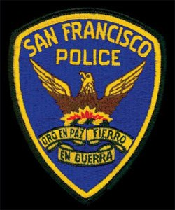 "The central emblem on the patch of the San Francisco, California, Police Department depicts a phoenix, a mythological bird. According to ancient mythology, a phoenix's tears have magical healing powers, and the creature experiences rebirth from its own ashes after death. Like the phoenix, San Francisco rose from the ashes after a devastating fire and earthquake in 1906. In the gold ribbon below the graphic reads the city's motto, which translates to ""Gold in Peace, Iron in War."""