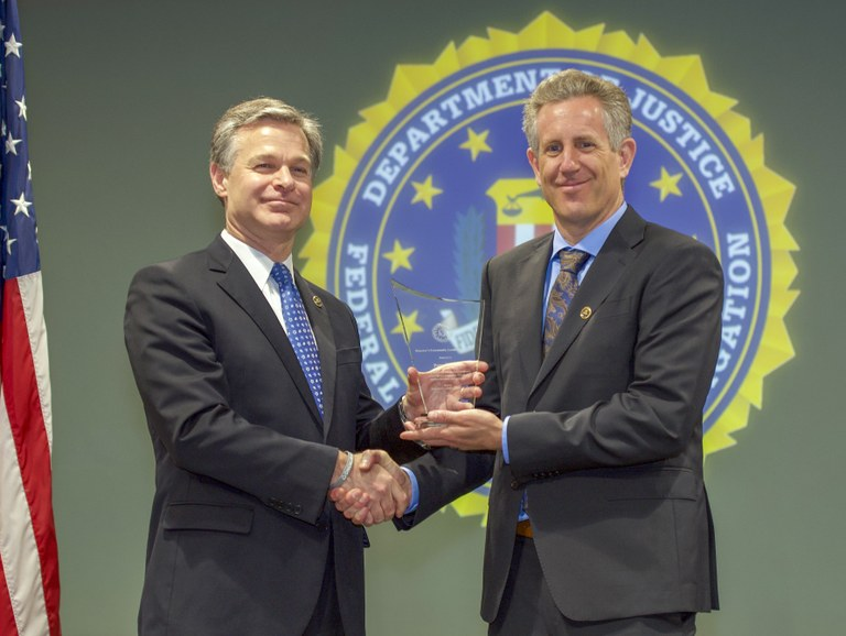 Image of Ed Kressy with FBI Director Christopher Wray.