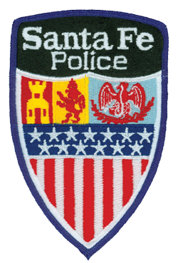 Santa Fe, New Mexico, is the oldest capital in the United States. On the patch of its police department, the shield depicts the castle from Juan de Onate, Spanish conquistador and explorer; the lion representing Diego de Vargas, who recaptured the city from the Pueblo Indians; and the Mexican Eagle.