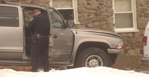 Officer Standing on Passenger Side of Vehicle