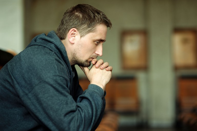 A stock image of a man who appears depressed.