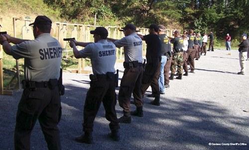Sheriff's Deputies Shooting Weapons at Gun Range