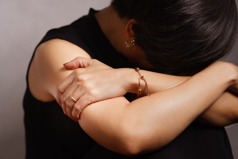 A stock image of a distraught female.