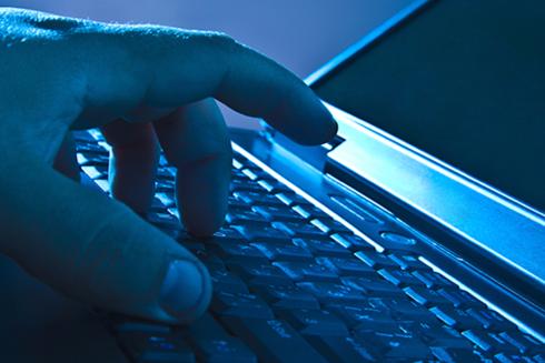 Hand on Laptop Keyboard (Stock Image)