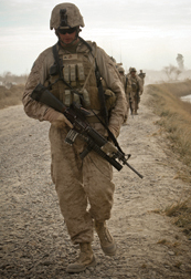 A soldier patrols with his assault rifle in hand. © marines.mil/Corporal Orlando Perez