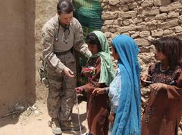 Soldier with Children in Iraq