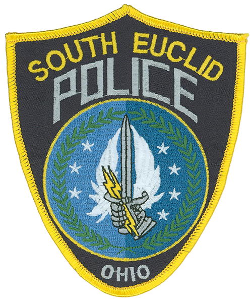 The patch of the South Euclid, Ohio, Police Department resembles a shield, which provides defense for officers. Within the shield, olive branches depict honor; two shades of blue represent night-and-day protection; an armored fist denotes the power of the law; a sword signifies justice, while lightning bolts allude to rapid response; wings signify peace; and seven stars represent the officers assigned each shift. An encircling yellow border suggests the rising sun and the beginning of new ideals for the department.