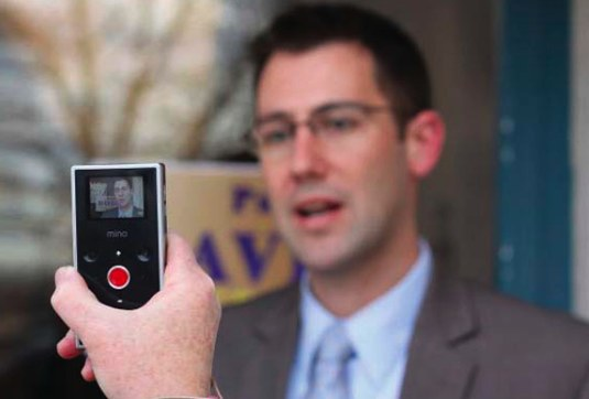 Speaking Man Being Recorded on Handheld Device