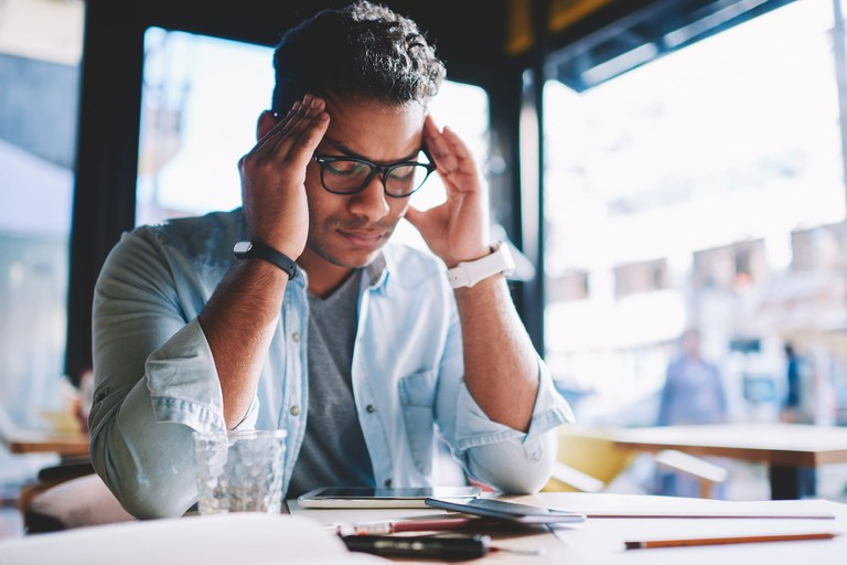 A stock photo of a male dealing with stress.
