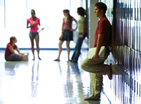 Stock image of high school students waiting in a hallway between classes. © Thinkstock.com