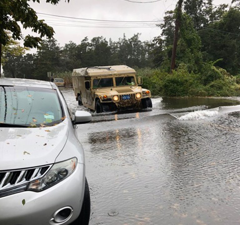 A photo provided by Chief Cameron of a police military vehicle maneuvering flood waters.