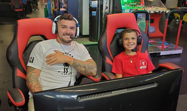 A photo of a Taunton police officer and a local youth at a video game event.