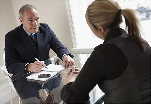 Businessman Interviews Woman for a Job (Stock Image)