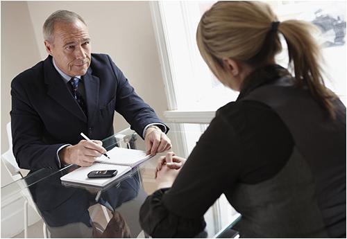 Businessman Interviews Woman for a Job (Stock Image)