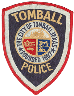 The Tomball, Texas, Police Department patch prominently features the seal of the city it serves. Founded in 1907, Tomball was named after Thomas Henry Ball, a turn-of-the-century Texas politician instrumental in routing the railroad through the area, giving it a population boom. The locomotive at the top of the seal references the city's railroad-driven past. The tractor and field on the left allude to Tomball's excellent farming and cattle-raising conditions—these two factors led to the area's initial settlement in the early-19th century. Several oil derricks on the right represent the city's part in the oil industry, which started with a 100-foot oil gusher on May 27, 1933, and led to an economic boom.