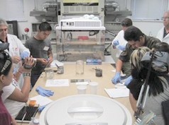 Trainees processing fingerprints at the Randall County, Texas, Sheriff's Office Crime Laboratory during a summer 2010 exchange program between West Texas A&M University and the San Miguel de Allende Police Department and city council.