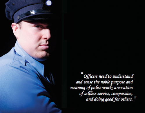 A police officer stares out of the darkness while imparting words of wisdom.