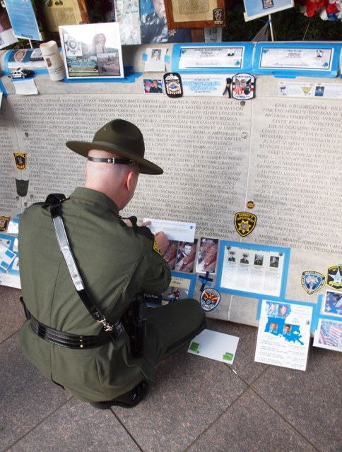 A trooper makes impressions of the names of other West Virginia State Police Troopers at the National Law Enforcement Officers Memorial.