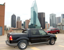 Depicted is the truck that housed Hosam Smadi's IED with the target building shown in the background. Smadi attempted to bomb Fountain Place in Dallas, Texas.