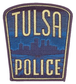 "Tulsa, Oklahoma, was once known as ""the oil capital of the world."" Its police department's patch, in the shape of a yield sign, includes a representation of the city's skyline."