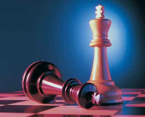 Two King Chess Pieces, One Toppled