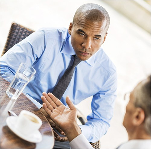 Stock image of two businessmen talking.