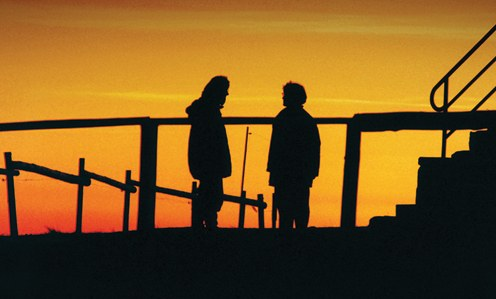 Stock image of two people silhouetted by a sunset. © Thinkstock.com