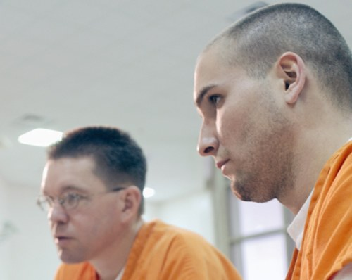 Two Prisoners in Orange Jumpsuits