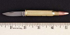 This photo depicts what appears to be a cartridge in a metallic case. Instead, a metal blade is inside the cartridge.