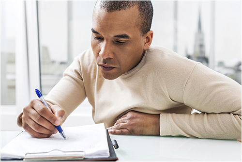 Man Takes Notes (Stock Image)