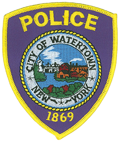 In April 1998 the Watertown, New York, Police Department adopted a new shoulder patch coinciding with its research into the city's past. In the center of the patch is Watertown's seal, which depicts the Black River, paper mills and factories formerly located along the river bank, and an old steel footbridge. The rope around the seal represents the department's strong ties to the community and its citizens. Watertown and the department both were incorporated in the year 1869, which is depicted on the patch. Three stars in the white border around the seal stand for the original members of the Watertown Police Department.