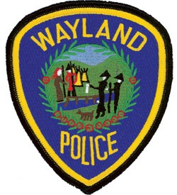The patch of the Wayland, Massachusetts Police Department depicts a historic scene. Pilgrims are waving a symbolic white cloth as the East Sudbury Plantation, which later became Wayland, was created.