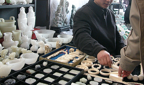 Illegal ivory sale in Panjiayuan Market in Beijing.