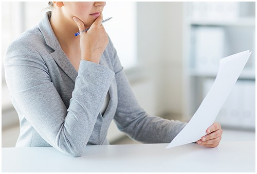 Stock image of a woman reading a report.