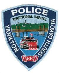 Yankton, South Dakota Police Department's patch reflects the city's history as the first capitol of Dakota Territory in 1861. The riverboat, chapel, and hospital also serve as reminders of Yankton's past, as does Discovery Bridge, representing the trek of Lewis and Clark up the Missouri River.