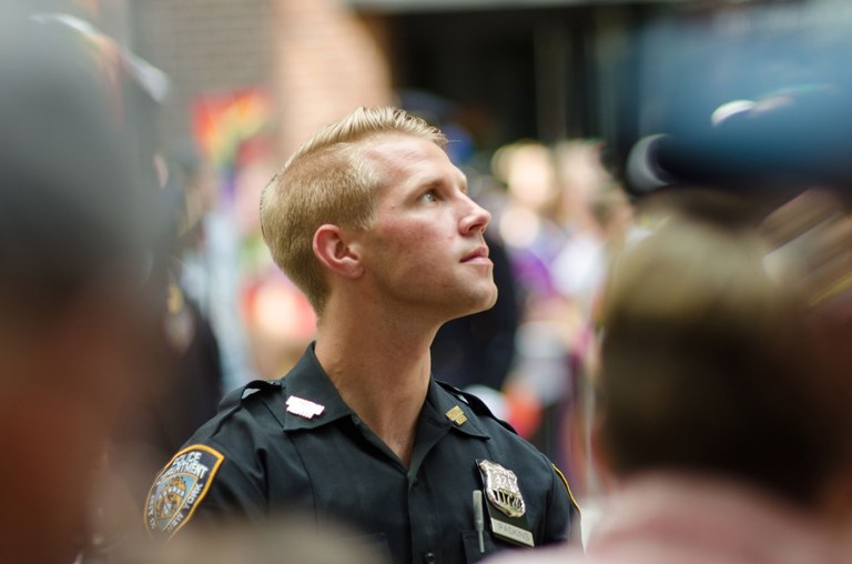 Stock photo of a young, male police officer.